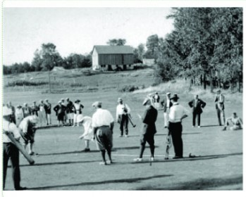 Black & White photo of players on the course
